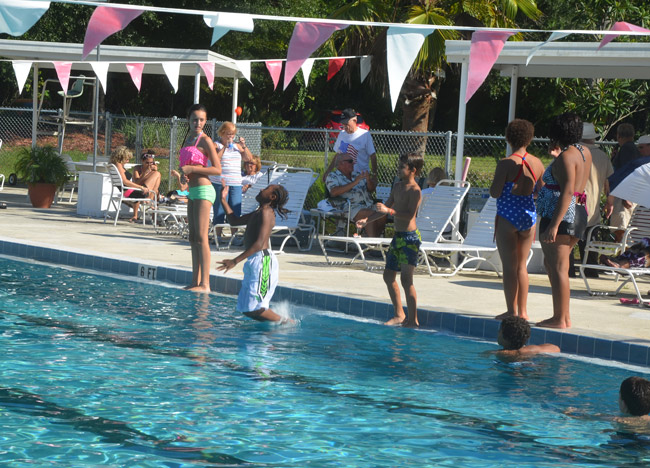 A crowd turned up at the Belle Terre Swim and Racquet Club fundraiser Sunday, but whether those who hope to save the facility can sustain interest is another matter. (© FlaglerLive)
