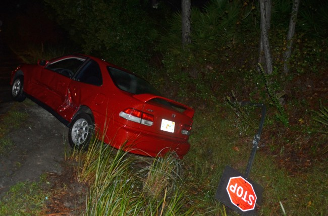 The Honda was forced into the ditch at the intersection of Belle Terre Parkway and Ponce de Leon Boulevard. (c FlaglerLive)