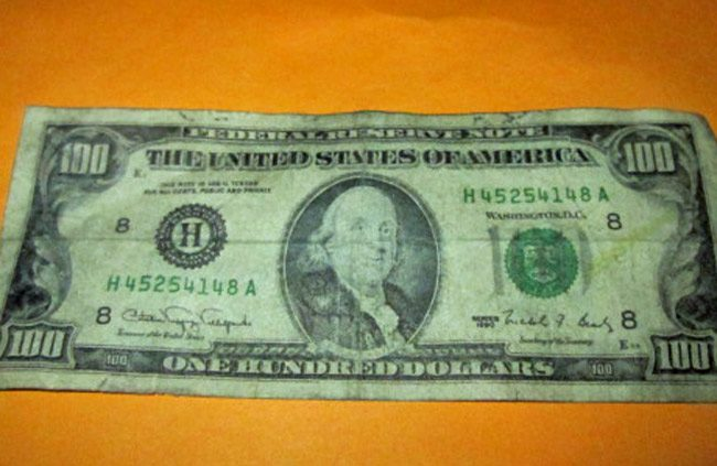 One of the counterfeit $100 bills used at a Palm Coast store, showing a somewhat more stupefied Benjamin Franklin than the Federal Reserve would allow. (FCSO)