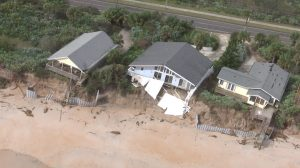 A half dozen homes along the shore just south of Varn Park on State Road A1A are feared lost as erosion continues to undermine their foundations. Click on the image for larger view. (Flagler County)