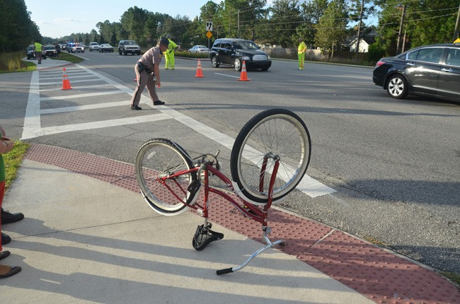Florida Highway Patrol investigators at the scene of a bicycle-and-vehicle crash on Belle Terre Parkway in 2012. (© FlaglerLive)