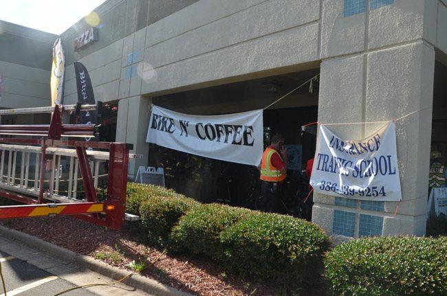 Friday morning's fire broke out at the Flagler Plaza Bike N Coffee shop. (© FlaglerLive)