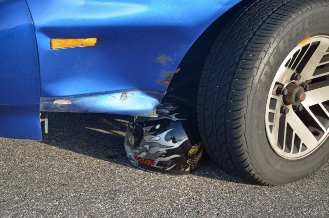 The victim was wearing his helmet, but was run over by the Firebird, which then dragged the helmet a distance from the point of impact. Click on the image for larger view. (© FlaglerLive)