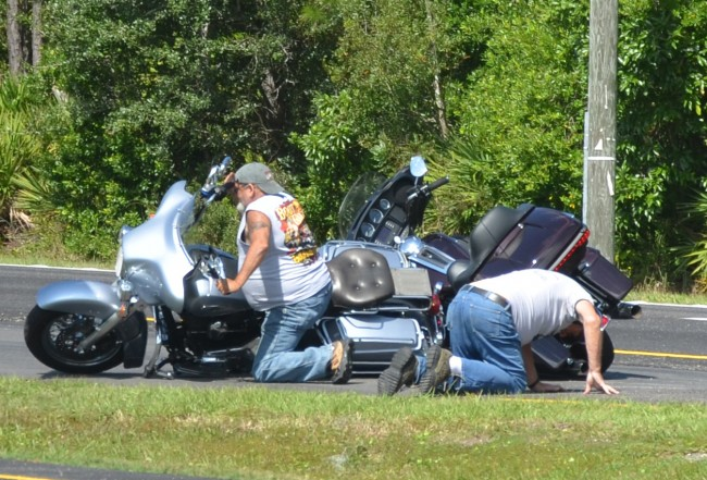 Two of the more than half dozen bikers and riders involved in the second wreck on U.S. 1 and CR304 immediately after they crashed this afternoon. Click on the image for larger view. (© FlaglerLive)