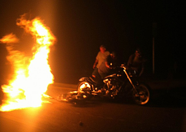 The motorcycle was almost immediately engulfed in flames. Click on the image for larger view. (© FlaglerLive)
