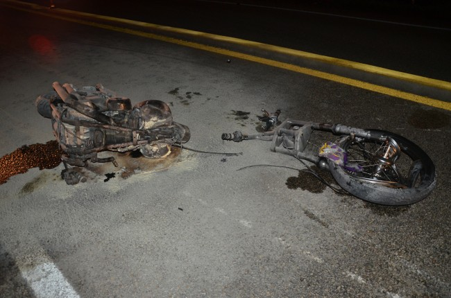 The UKC motorcycle was split and incinerated in the collision. Click on the image for larger view. (© FlaglerLive)