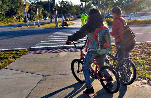 The study found ample bike riding at some of the district's schools, but traffic jams reduce the bikers' safety. (Kittleson and Associates)