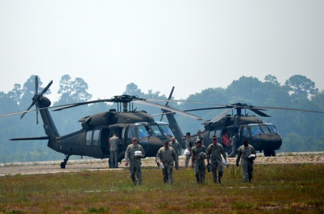 The right stuff: the Florida Army National Guard's Black Hawk crews right after arriving in Flagler County on Wednesday. (© FlaglerLive)