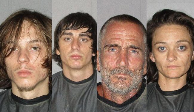 Four of the six individuals arrested today on Blueberry Street in the Mondex. From left, Anthony S. Pezza, Gage R. Watts, Kenneth Driggers, and Amanda Parker.