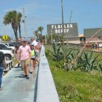 Flagler Beach's boardwalk in pre-distancing days, last fall. (© FlaglerLive)