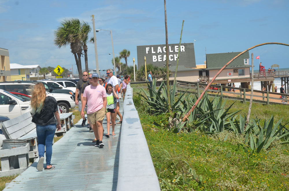 Flagler Beach's boardwalk in pre-distancing days, last fall. (© FlaglerLive)
