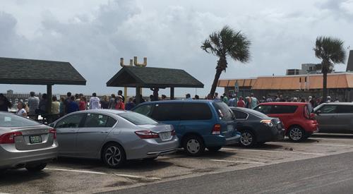 Spectators on Flagler Beach's boardwalk well past noon today. (© FlaglerLive)
