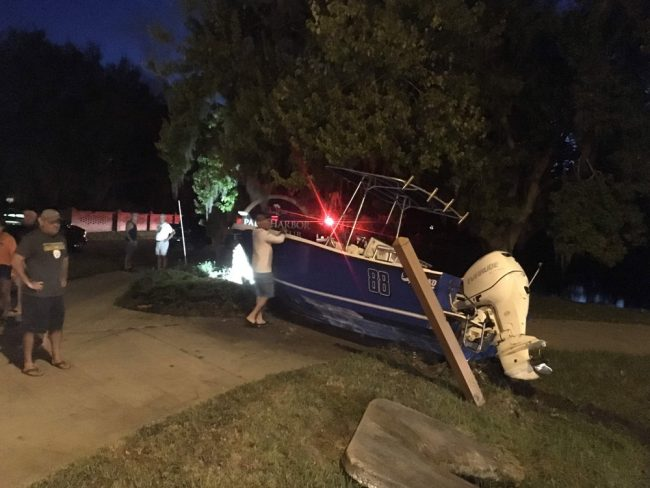 The boat knocked down a concrete culvert pillar and bent another on its way to  the sign. (© FlaglerLive)