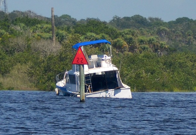 The boat struck ground just north of mile marker 22 on the Intracoastal. Click on the image for larger view. (© FlaglerLive)