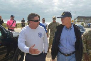 Flagler Beach Fire Chief Bobby Pace with the governor. Click on the image for larger view. (c FlaglerLive)