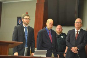 Joseph Bova, second from left, with his attorneys, Josh Mosley, left, and Matt Phillips. (© FlaglerLive)