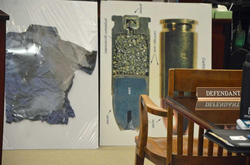 A display by the prosecution for the jury showing the sort of ammunition Joseph Bova fired at Zuheili Rosado when he murdered her in 2014, and the shirt Rosado was wearing at the time. The display was shown the jury on Wednesday as Bova's trial continues this week. See details below. (© FlaglerLive)