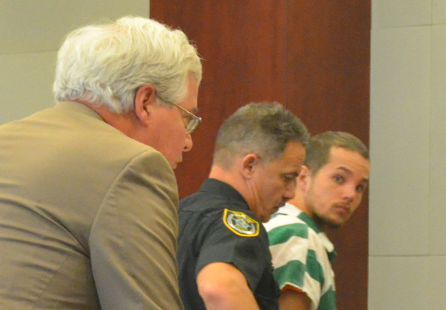 Joseph Bova II on his way out of the courtroom Tuesday, with his attorney, Ray Warren, left, looking on. (© FlaglerLive)