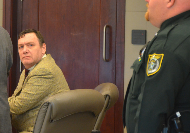 Michael Bowling, in court this afternoon, will not soon be freed of wardens despite today's mistrial. (c FlaglerLive)