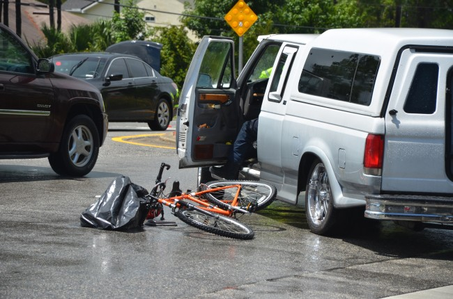 The boy's bike and the SUV that struck it, minutes after the collision, in the middle of Belle Terre Parkway.  Click on the image for larger view. (© FlaglerLive)
