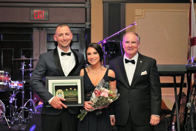 Braxton Hall, left, is the Flagler County Sheriff's Deputy of the Year. He accepted the award at Sheriff Rick Staly's (right) first annual gala for an employee trust fund Saturday evening. (FCSO)