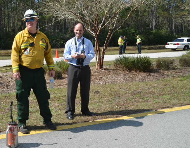 On the beat: Brian McMillan, right, with Will Raulerson of the  Florida Forestry Service, at the Seminole Woods Boulevard fire earlier this week. (c FlaglerLive)