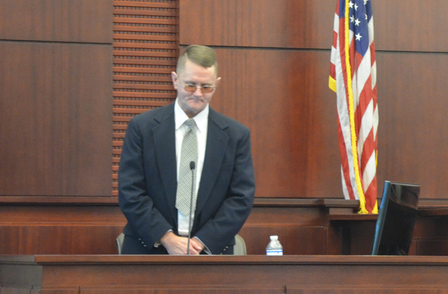 Bruce Haughton during his testimony today in his own defense. He asked to stand up at one point, saying his back was hurting from a debilitating pain, though he had spent all three days of trial until then sitting at his defense chair for long stretches but for occasional breaks. (c FlaglerLive)
