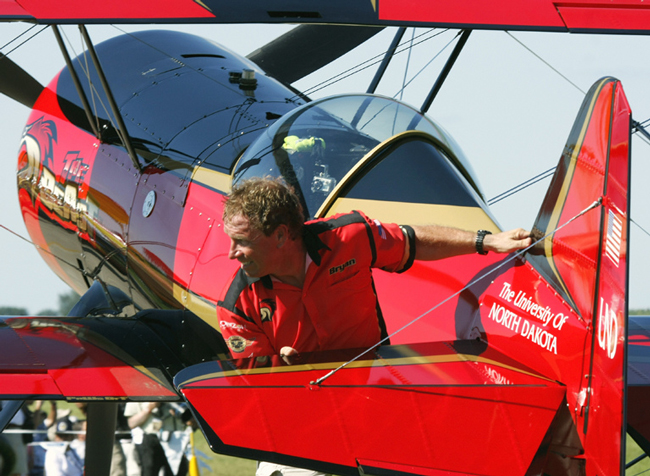 """Bryan Jensen with the plane he calls """"The Beast"""" after a performance last year at Wisconsin's Air Venture in Oshkosh, Wisconsin. (© vikingnav)"""