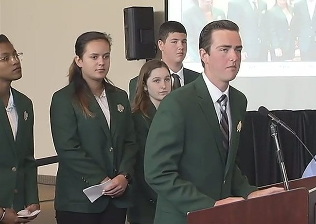 Five of the six students who form the Bulldog Patrol as they spoke to the Marjorie Stoneman Douglas commission Tuesday. From left, Gabrielle Jackson, Katia Martynuk, Abby Carver, Nicholas Blumengarten, and William Patin. Not pictured (but see below), Abbigail Carver. (© FlaglerLive via Florida Channel)