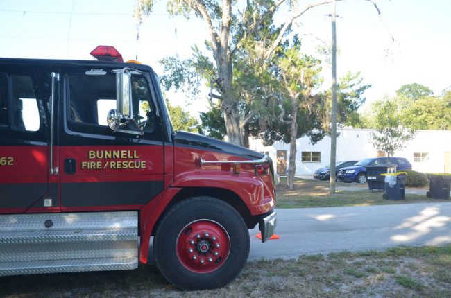 The Bunnell Firte Department's personnel drove in two fire engines and an SUV to park outside Monday's meeting. Click on the image for larger view. (© FlaglerLive)
