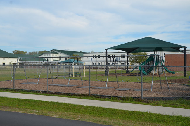 One of the playgrounds on the 20-acre Bunnell Elementary campus, where children were playing when a suspended student on the street side of the fence allegedly pulled a gun and pointed it at a student in the playground. That area of the school, along East Magnolia School, is oriented toward the northwest. (© FlaglerLive)
