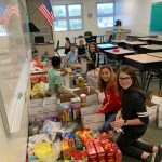 Bunnell Elementary School students this week preparing some of the 81 boxes of goodies for shipment to U.S. servicemen overseas. (Carmen Sanford)