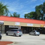Bunnell's utility billing and Community Development offices will move to a storefront at the strip mall behind the Chicken Pantry in Bunnell, off State Road 100. (© FlaglerLive)