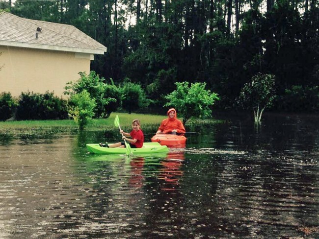 Austin McKay and his father Brian today on Burbank Drive in Palm Coast. Click on the image for larger view. (c Angela McKay for FlaglerLive)