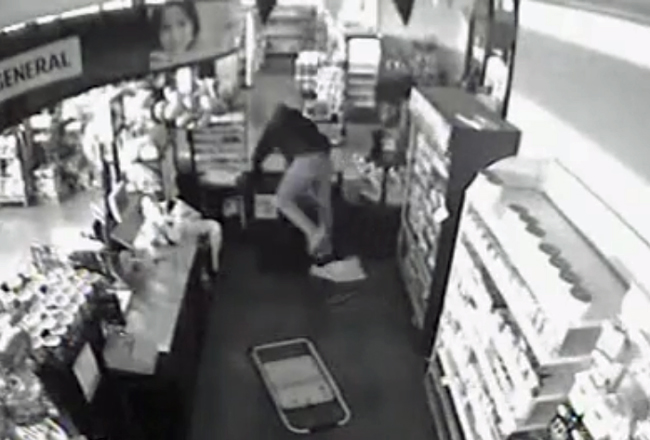 The burglar, caught on surveillance video, tried to smash tie cigarette machine with a metal chair, failed, then fled.
