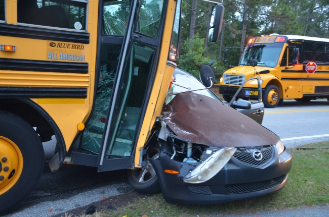 The Mazda was catapulted in the way of the bus. Click on the image for larger view. (© FlaglerLive)