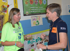 Angela Bush, left, who heads the school district's food services division, with UF's Maia McGuire, marine extension agent and leader of an initiative raising awareness about  microplastics. (© FlaglerLive)