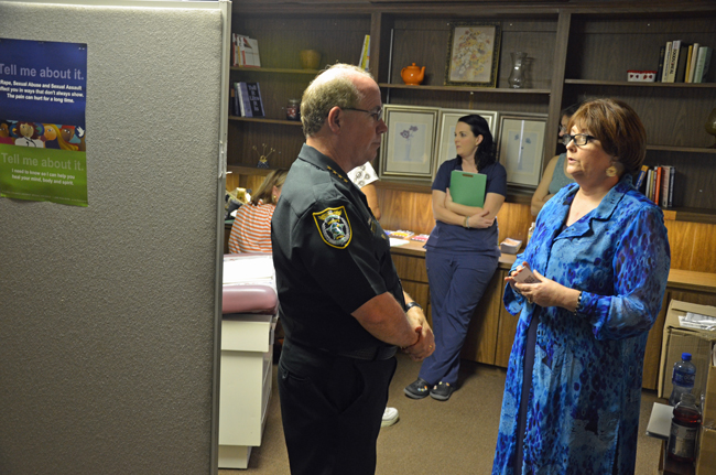 In July, Sheriff Jim Manfre, seen here speaking with the Children Advocacy Center's Terri Karol, the CAC's vice president for financial operations, was among several top officials--including State Attorney R.J. Larizza--who toured the CAC's new facility in Bunnell, where the center pledged it would provide rape exams to adult victims. The pledge proved hollow. (© FlaglerLive)