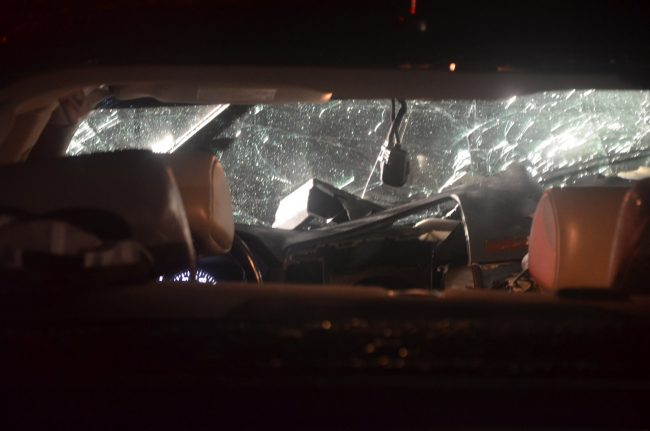 The Cadillac's rear windshield was shattered. Click on the image for larger view. (© FlaglerLive)