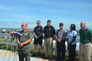 County and city officials in a show for the cameras Sunday in Flagler Beach, with each taking the mic in turn. Flagler County Sheriff Jim Manfre rode with Gov. Scott today. He did not return a call asking for details of his conversations with the governor. Click on the image for larger view. (c FlaglerLive)