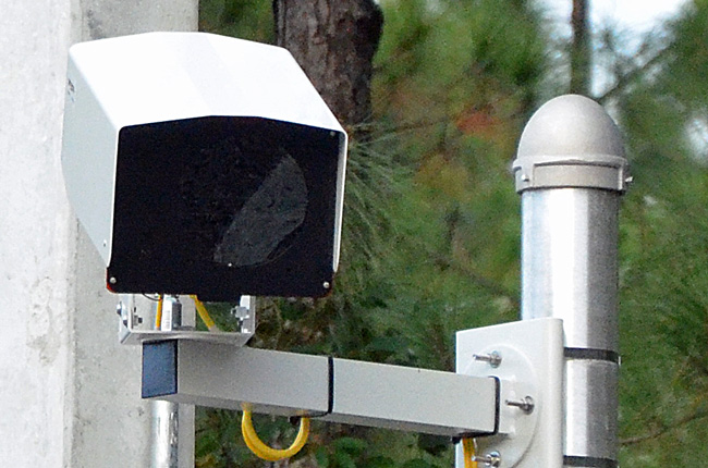 Pay now, or pay not and gamble: drivers have a choice in Palm Coast when faced with a red-light camera violation. (© FlaglerLive)