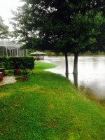 The canal near Boulder Rock Drive encroached on a property. 'We have suffered extensive flooding since they 'repaired' a dam nearby. It's eroding our back yard,' says Leann Pennington, who contributed this photo. Click on the image for larger view.