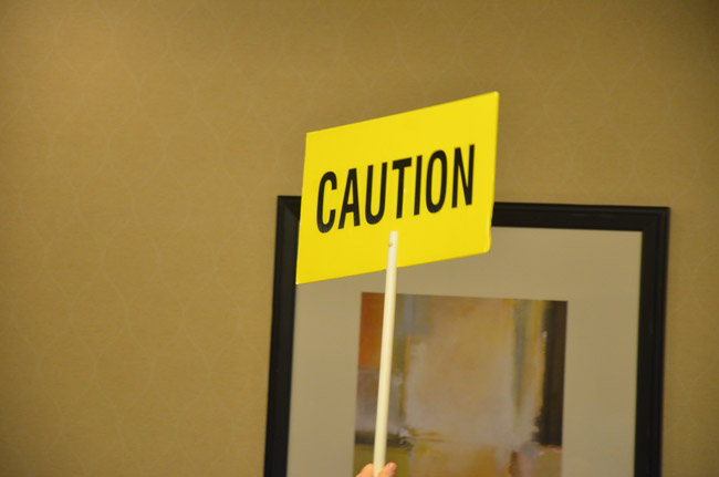 The caution sign at the candidate forum is often the steepest challenge candidates will face. (© FlaglerLive)