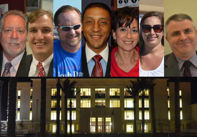 The seven candidates for Flagler County Judge looking to replace Sharon Atack and move into the building below. In alphabetical order from left, Don Appignani, Craig Atack, Josh Davis, Marc Dwyer, Sharon Feliciano, Melissa Moore-Stens, and W. Scott Westbrook. (© FlaglerLive)