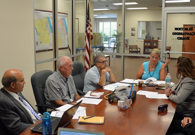 Days of controversy: Ex-Supervisor of Elections Kimberle Weeks, at the head of the table, in a canvassing board meeting in August, with, from left, County Attorney Al Hadeed, Commissioners Charlie Ericksen and George Hanns, both of whose resignations from the canvassing board Weeks forced, and County Judge Melissa Moore-Stens, who also called for Hanns's resignation. He was replaced by Commissioner Barbara Revels. (© FlaglerLive)
