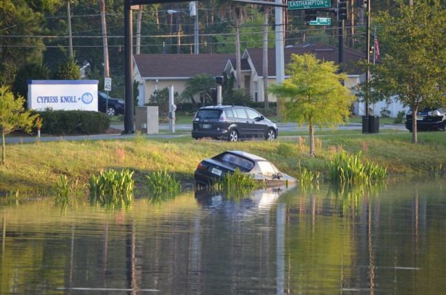 A pair of bus drivers called in their spotting of the Honda in the retention pond at 6:41 Wednesday morning. (© FlaglerLive)