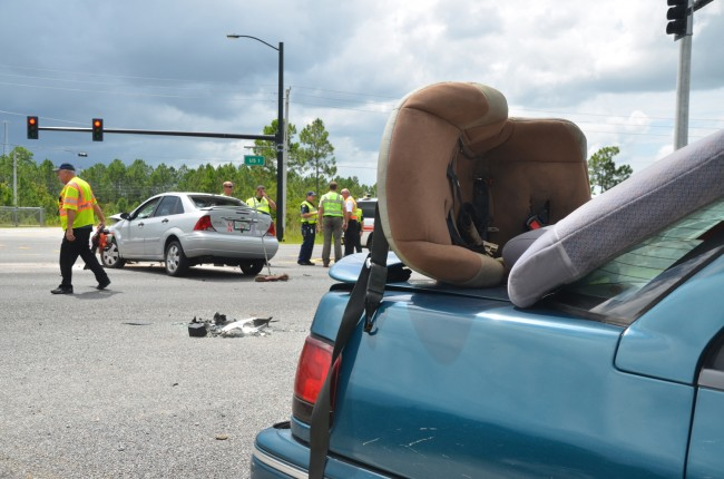 The child seat was taken out of the Mercury and placed on the trunk by emergency personnel and was unoccupied when the wreck took place. Click on the image for larger view. (© FlaglerLive)