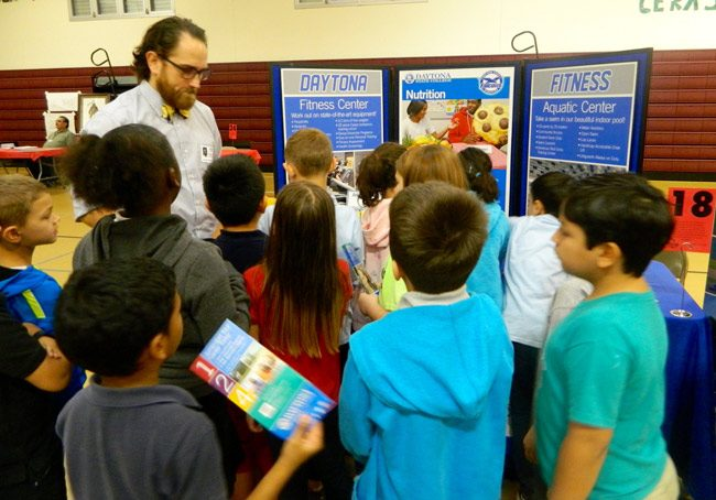 Daytona State College's Zachary Cordell with students during Rymfire Elementary's Career Day last Friday. (Melanie Tahan)