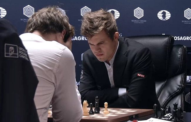Norway's Magnus Carlsen  battling Russia's Sergey Karjakin in Tuesday's epic fourth match of the World Chess Championship in new York. Go here to follow the games.