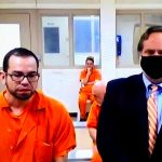 Daniel Danny Catalan, left, with his attorney, Josh Davis, in a video appearance from the county jail. (© FlaglerLive via Court Services)